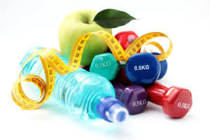 Dumbells, Water, Measuring Tape and Apple